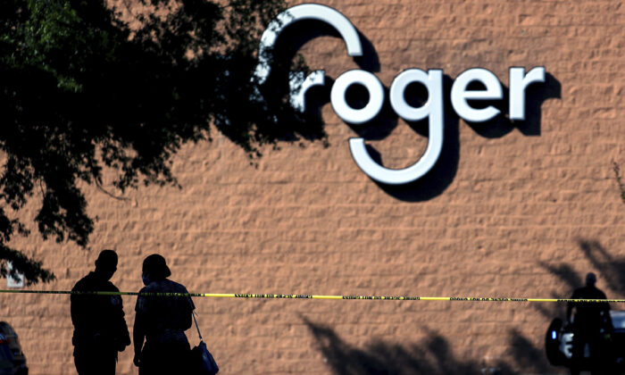 Police guard the crime scene following a shooting at a Kroger's grocery store in Collierville, Tenn., on Sept. 23, 2021. (Patrick Lantrip/Daily Memphian via AP)