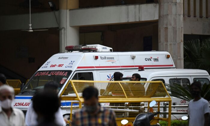 An ambulance is seen inside the Rohini court in New Delhi, India, on Sept. 24, 2021, after a notorious Indian gangster was killed by gunmen dressed as lawyers in a bloody shootout in a courtroom where three people died. (Money Sharma/AFP via Getty Images)