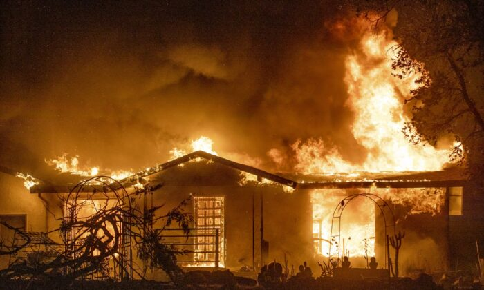 A house burns on Platina Road at the Zogg Fire near Ono, Calif., on Sept. 27, 2020. (Ethan Swope/AP Photo)