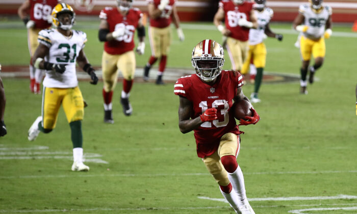 Richie James #13 of the San Francisco 49ers runs for a touchdown against the Green Bay Packers during the fourth quarter at Levi's Stadium in Santa Clara, Calif., on Nov. 5, 2020. (Ezra Shaw/Getty Images)