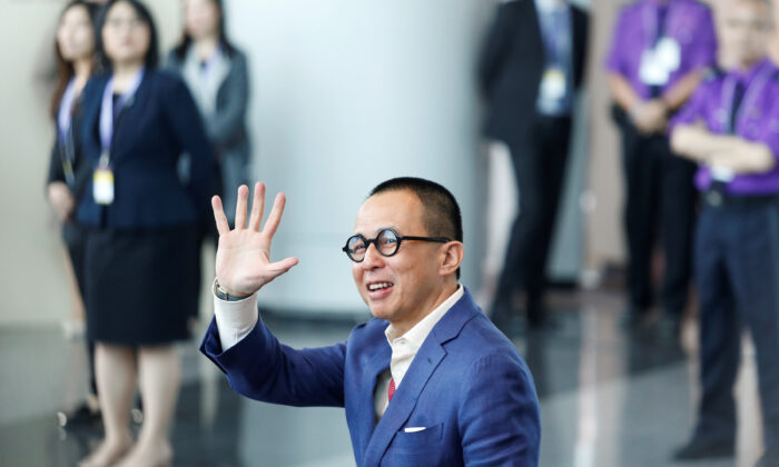 Richard Li, Hong Kong businessman and younger son of tycoon Li Ka-shing, waves as he arrives to vote during the election for Hong Kong's next Chief Executive in Hong Kong, on March 26, 2017.   (Bobby Yip/Reuters)