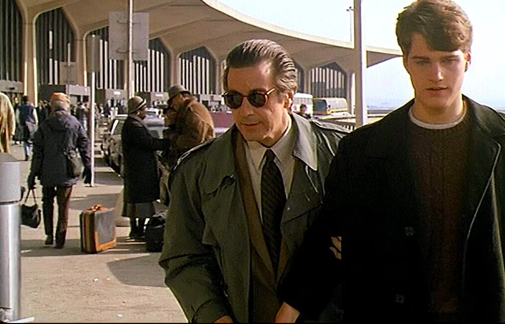 man with sunglasses and boy in black coat in SCENT OF A WOMAN