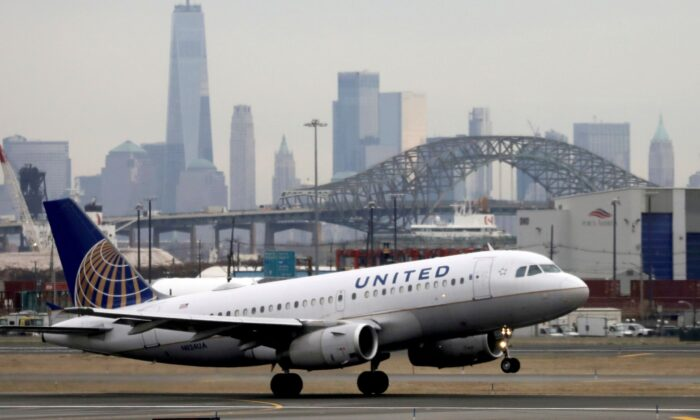 A United Airlines passenger jet takes off with New York City as a backdrop, at Newark Liberty International Airport in New Jersey on Dec. 6, 2019. (Chris Helgren/Reuters)