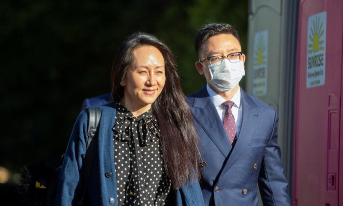 Huawei Technologies Chief Financial Officer Meng Wanzhou leaves her home to attend a court hearing in Vancouver, British Columbia, Canada on Sept. 24, 2021.  (Taehoon Kim/Reuters)