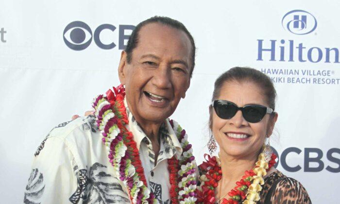 Al Harrington and Rosa Navarro-Hoffman during the Hawaii Five-O and Magnum P.I. Sunset On The Beach event on Waikiki Beach, in Honolulu, Hawaii, on Sept. 19, 2019. (Michael Sullivan/CSM/Zuma Press/TNS)