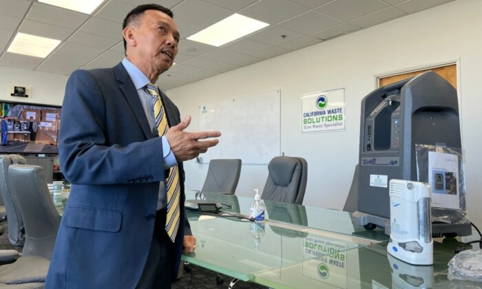 David Duong, CEO of California Waste Solutions, shows one of the oxygenators he is donating to Vietnam to help people suffering from COVID-19. (Ted Lin/The Epoch Times)