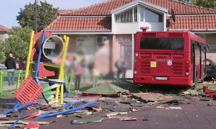 A public bus swerves off the road into a children's playground in a residential area of Belgrade, Serbia, on Sept. 24, 2021. (Tanjug via AP/Screenshot via NTD)