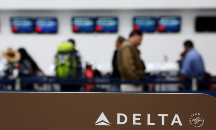 Passengers check in at a counter of Delta Air Lines in Mexico City, Mexico, on Aug. 8, 2016. (Ginnette Riquelme/Reuters)