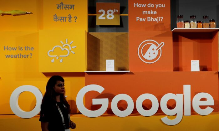 A woman walks past the logo of Google during an event in New Delhi, India, on Aug. 28, 2018. (Adnan Abidi/Reuters)