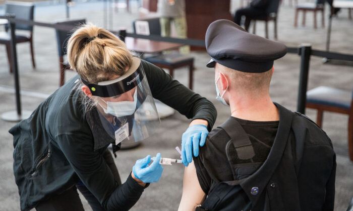 A police officer receives his COVID-19 vaccination at in Foxborough, Mass., on Jan.15, 2021. (Scott Eisen/Getty Images)