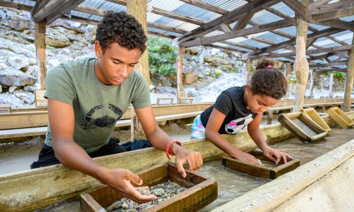 Children sluice at Emerald Village Gemstone Mine in North Carolina. (Courtesy of VisitNC.com)