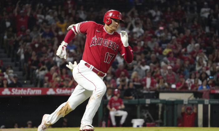 Los Angeles Angels designated hitter Shohei Ohtani rounds first on his way to a triple during the third inning of a baseball game against the Seattle Mariners in Anaheim, Calif., on Sept. 25, 2021. (AP Photo/Mark J. Terrill)