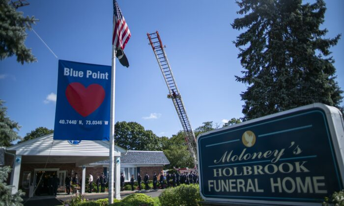 Long Island firefighters attend the funeral home viewing of Gabby Petito at Moloney's Holbrook Funeral Home in Holbrook, N.Y., on Sept. 26, 2021. (Eduardo Munoz Alvarez/AP Photo)