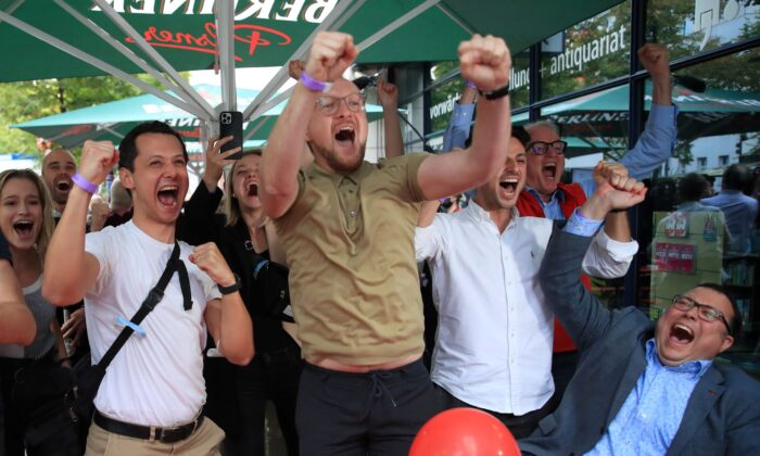 Social Democratic Party (SPD) supporters react after first exit polls for the general elections in Berlin, Germany, on Sept. 26, 2021. (Wolfgang Rattay/Reuters)