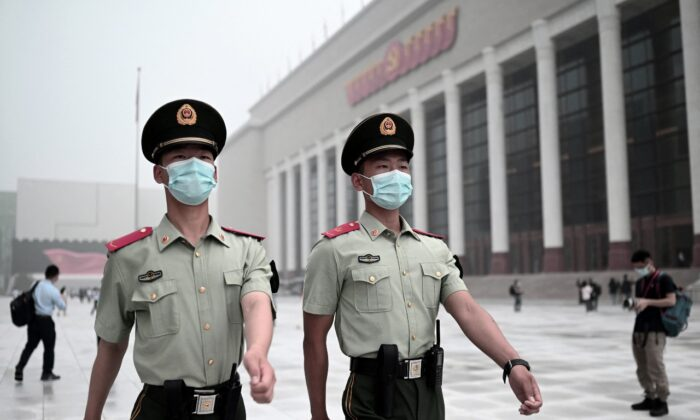 Paramilitary police walk outside the Museum of the Communist Party of China, near the Birds Nest national stadium in Beijing on June 25, 2021. (Noel Celis/AFP via Getty Images)