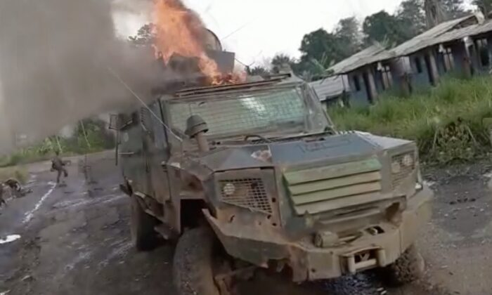A screenshot from a video released by Ambazonia rebels showing an armored personnel carrier on fire on Sept. 14 in the Northwest region of Cameroon. (screenshot Ambazonia rebel video/The Epoch Times)