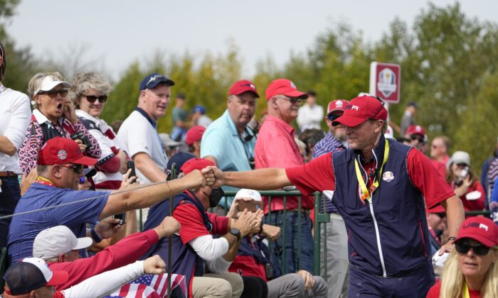 Team USA captain Steve Stricker greets fans on the second hole during a Ryder Cup singles match at the Whistling Straits Golf Course in Sheboygan, Wis., on Sept. 26, 2021. (Jeff Roberson/AP Photo)