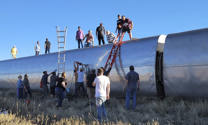 People work at the scene of an Amtrak train derailment in North Central Montana on Sept. 25, 2021. (Kimberly Fossen via AP)