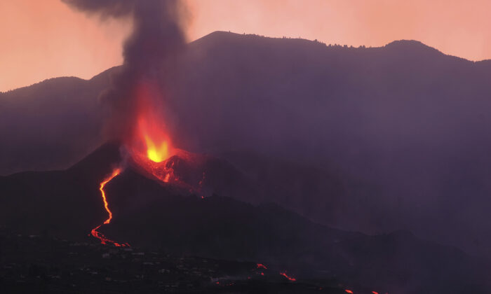 Lava flows from a volcano on the Canary island of La Palma, Spain in the early hours of Sept. 26, 2021. (Daniel Roca/AP Photo)