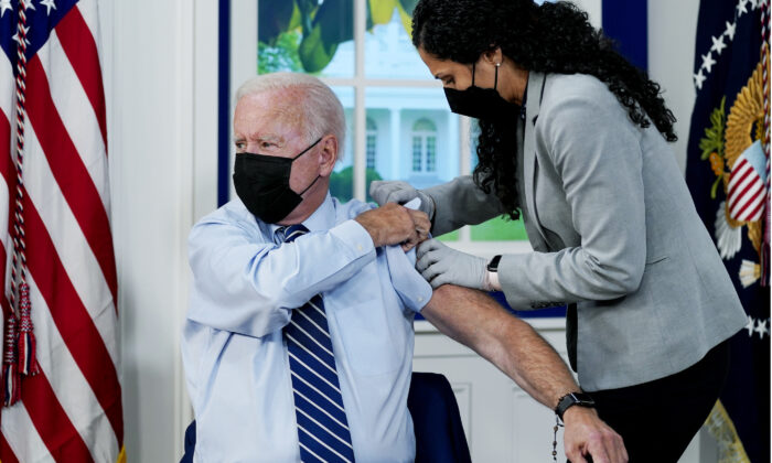 President Joe Biden receives a COVID-19 booster shot during an event in the South Court Auditorium on the White House campus in Washington on Sept. 27, 2021. (Evan Vucci/AP Photo)