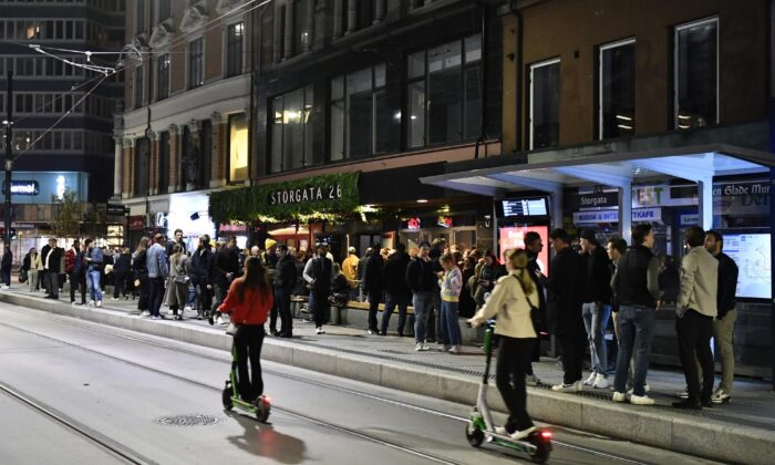 People out on the streets to celebrate the end of the COVID-19 restrictions, in Oslo, on Sept. 25, 2021. (Naina Helen Jama/NTB via AP)