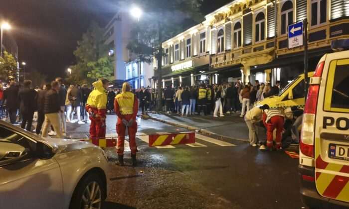 An ambulance takes care of the injured as Norway reopens from COVID-19 restrictions in Trondheim, Norway, on Sept. 25, 2021. (Joakim Halvorsen/NTB via AP)