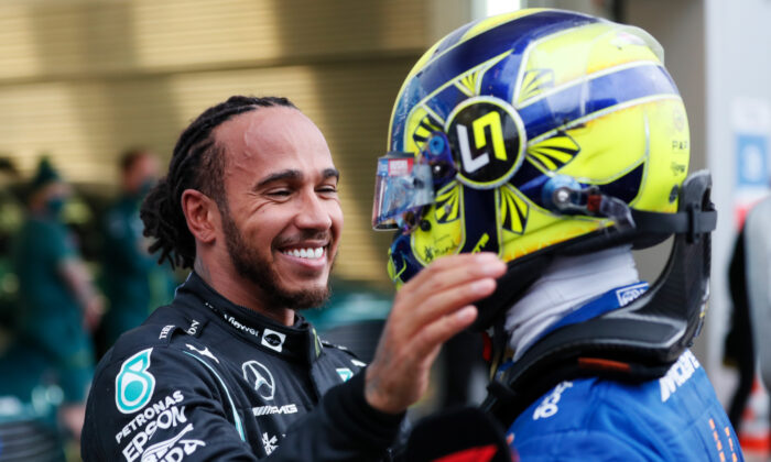 Race winner Lewis Hamilton of Great Britain and Mercedes GP hugs Lando Norris of Great Britain and McLaren F1 in parc ferme during the F1 Grand Prix of Russia at Sochi Autodrom in Sochi, Russia, on Sept. 26, 2021. (Yuri Kochetkov/Getty Images)