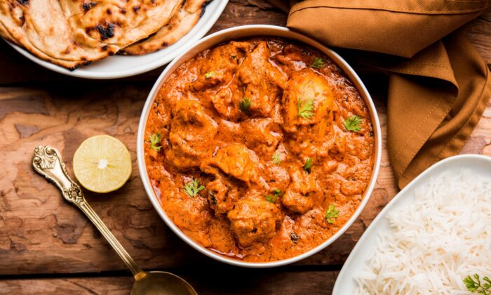 In butter chicken, tomatoes surrender to the pan, combining with cream, butter, and a medley of spices and aromatics to make a rich gravy. (Indian Food Images/Shutterstock)