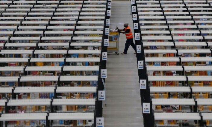 A worker collects orders at Amazon's fulfillment center in Rugeley, central England, on Dec. 11, 2012. (Phil Noble/Reuters)