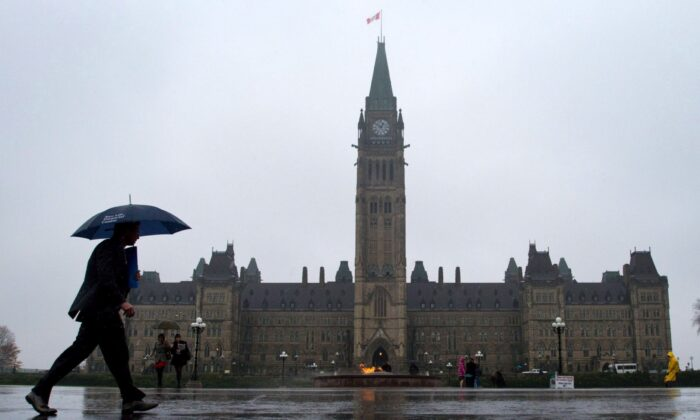 Pedestrians make their way across Parliament Hill in Ottawa in a file photo. (The Canadian Press/Sean Kilpatrick)