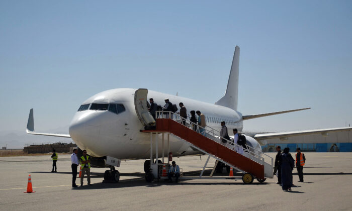 Passengers board a commercial aircraft bound to Kabul at Herat Airport in Afghanistan on Sept. 22, 2021. (Hoshang Hashimi/AFP via Getty Images)