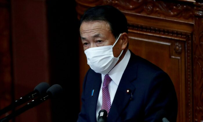 Japan's Deputy Prime Minister and Finance Minister Taro Aso, wearing a protective face mask, delivers his policy speech at the opening of an ordinary session of the parliament in Tokyo, Japan on Jan. 18, 2021. (Issei Kato/Reuters)