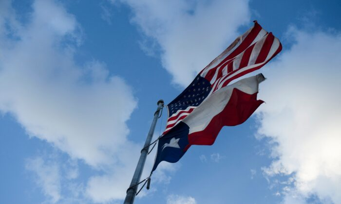 The United States Flag and Texas State Flag are displayed at Murchison Rogers Park in El Paso, Texas, on June 24, 2021. (Patrick T. Fallon/AFP/Getty Images)
