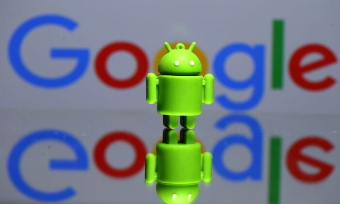 A 3D printed Android mascot Bugdroid is seen in front of a Google logo in this illustration taken on July 9, 2017. (Dado Ruvic/Illustration/Reuters)