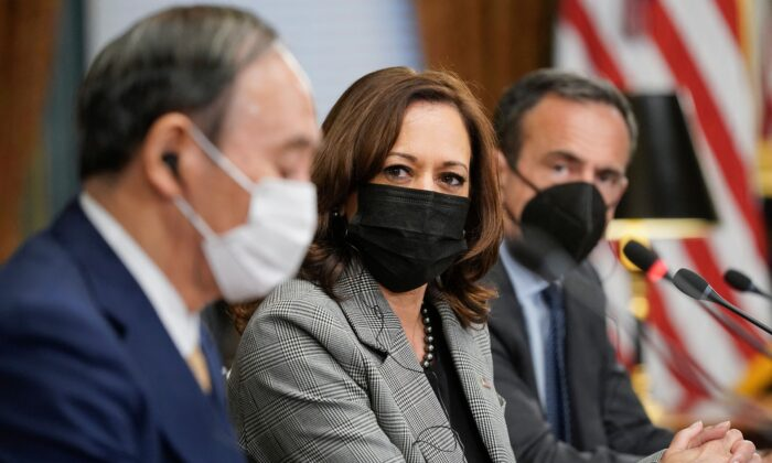 U.S. Vice President Kamala Harris, center, meets with Japanese Prime Minister Yoshihide Suga, left, in the Vice President's Ceremonial Office at he Eisenhower Executive Office Building next to the White House in Washington on Sept. 24, 2021. (Patrick Semansky/Pool/AFP via Getty Images)