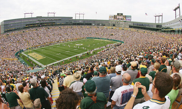 Green Bay Packers fans cheer from the stands against the Cleveland Browns at Lambeau Field in this file photo. (Jeff Gross/Getty Images)