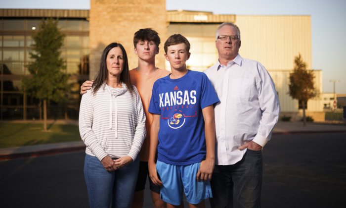 Karen Riggs and her husband, Mike Riggs, stand with their sons, Resurrection Christian School junior Charlie Riggs, 16 (2nd L), and freshman Graham Riggs, 13, outside the school in Loveland, Colo., on Sept. 27, 2021. (Michael Ciaglo for the Epoch Times)
