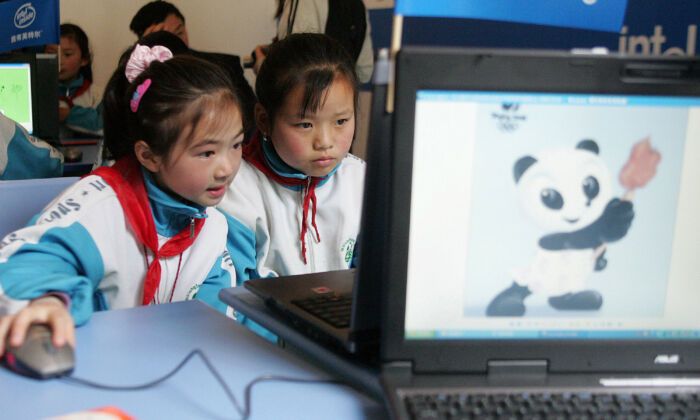 Students use computers to gather information in the Shawan Primary School in Wolong of Sichuan Province, China on May 20, 2005. (China Photos/Getty Images)