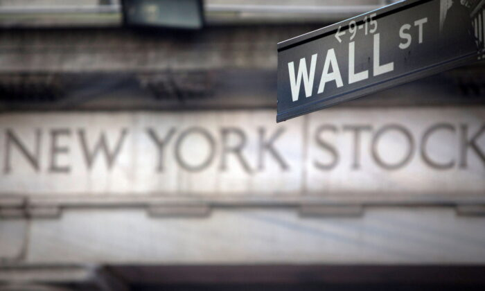 A Wall Street sign outside the New York Stock Exchange in New York on Oct. 28, 2013. (Carlo Allegri/Reuters)