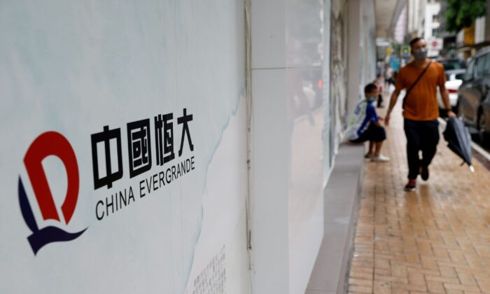 China Evergrande logo is displayed outside China Evergrande Centre building in Hong Kong, on Sept. 23, 2021. (Tyrone Siu/Reuters)