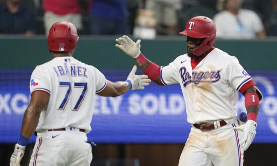 Garcia Sets Rookie HR Record in 7-6 Rangers Win Over Angels