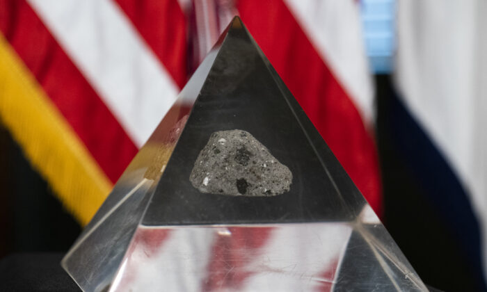 A fragment of the moon rock collected by astronaut John Young, commander of the Apollo 16 lunar mission, is displayed, in Washington on May 3, 2021. (Manuel Balce Ceneta/AP Photo)
