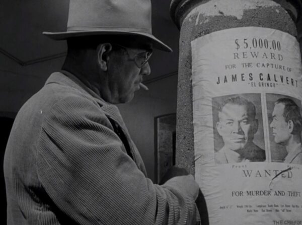 a man and wanted poster