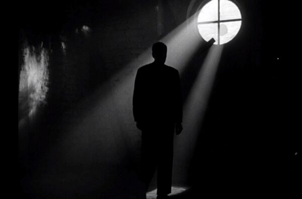 a priest's silhouette