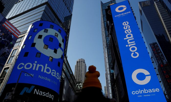 The logo for Coinbase Global Inc, the biggest U.S. cryptocurrency exchange, is displayed on the Nasdaq MarketSite jumbotron and others at Times Square in New York, on April 14, 2021. (Shannon Stapleton/Reuters)