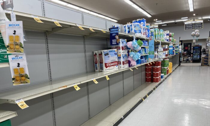 Empty shelves greet a customer at a Safeway grocery store in Williams, Arizona, on Sept. 26, 2021. (Allan Stein/Epoch Times)