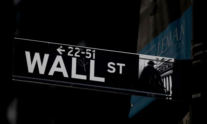 A Wall St. street sign is seen near the New York Stock Exchange (NYSE) in New York City on Sept. 17, 2019. (Brendan McDermid/Reuters)