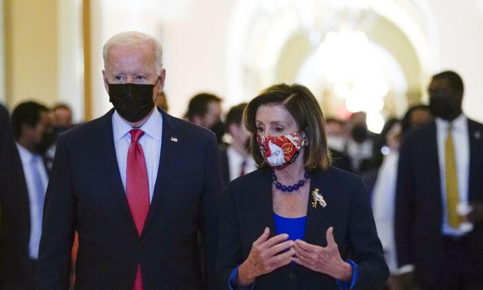 President Joe Biden walks with House Speaker Nancy Pelosi (D-Calif.) on Capitol Hill on Oct. 1, 2021. (Susan Walsh/AP Photo)
