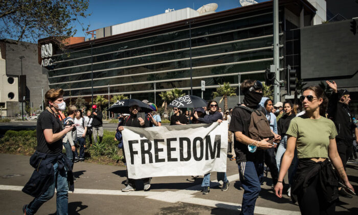 Protesters march along Southbank Boulevard in Melbourne, Australia, on Oct. 2, 2021. (Darrian Traynor/Getty Images)