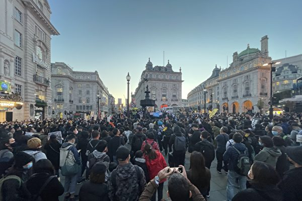 Human rights groups protest the CCP's atrocities in London, on Oct. 1, 2021. (Wen Qing/The Epoch Times)
